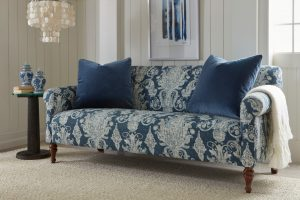 Transform your space by incorporating Classic Blue, the 2020 Pantone Color of the Year, with this upholstered sofa featuring a bold, blue print in plush velvet.