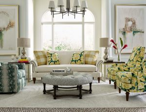 Make an impact in your Chattanooga living room with a white sofa to add contrast against a dark, moody wall.