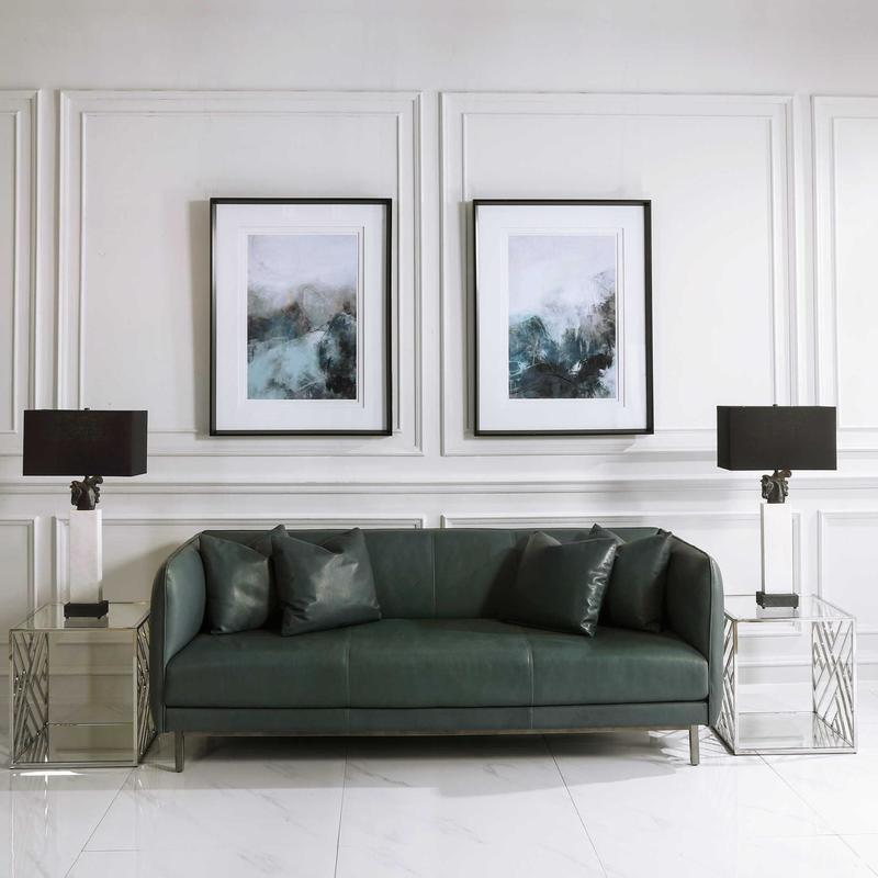 When planning your Chattanooga interior design elements, be sure to hang artwork at eye level.