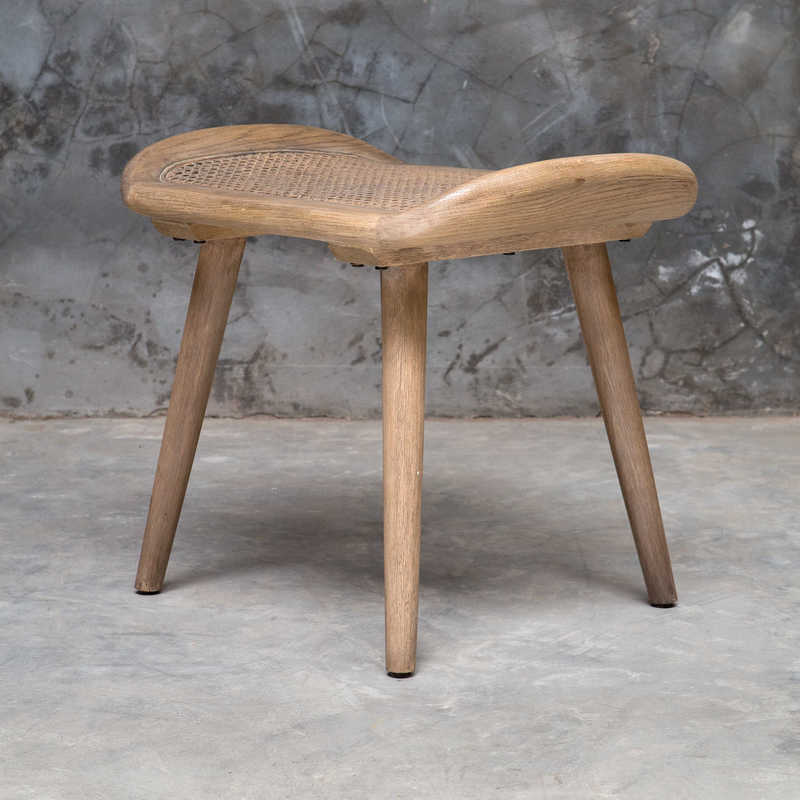 Scandinavian design also incorporates wood accents like this little stool by Uttermost.
