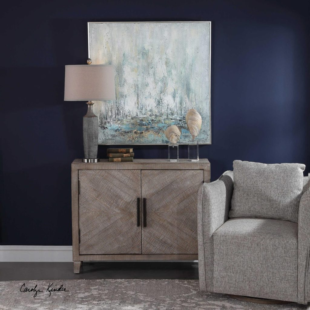 Take your Chattanooga interiors to a new level when you level up your hallways with functional pieces like this Uttermost two-door cabinet.