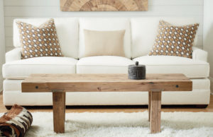 Use a bench like this one by Hammary for a functional furniture choice in your living space.