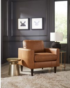 This camel colored leather chair by Best Home Furnishings will help add depth to your Chattanooga living room furniture.