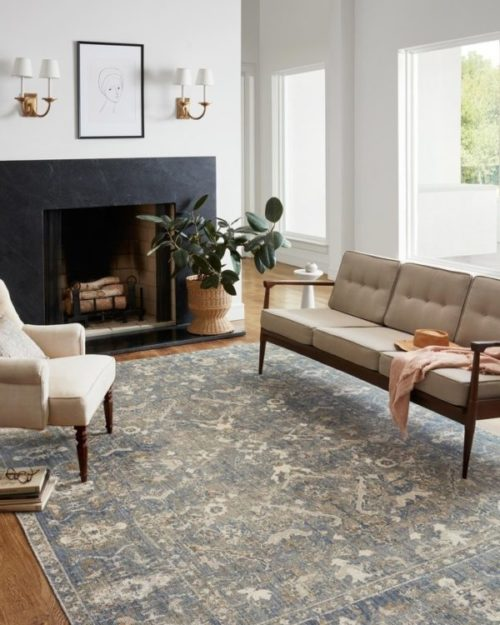 This area rug is a perfect home decor piece that adds a pop of color and design to any living room.