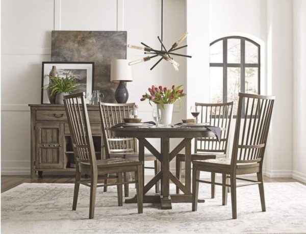 This wood style round dining table by Kincaid is a great place to add accent home decor.