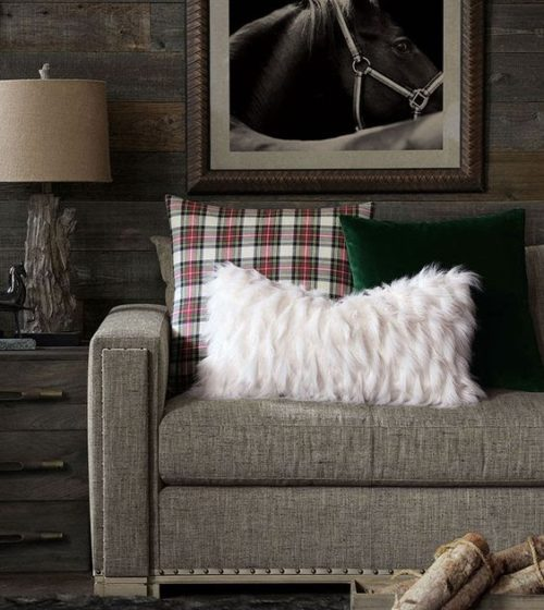 This plaid pillow accent piece provides a cozy holiday vibe