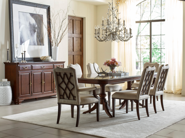 Modern decor dining table by Kincaid adds fresh look to traditional dining room.