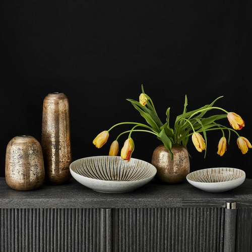 Decor pieces by Kincaid featuring an accent vase.