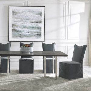 Armless dining chars by Uttermost displayed in a beautiful dining room