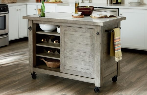 Space saving furniture island piece by Hammary pulls the kitchen together.