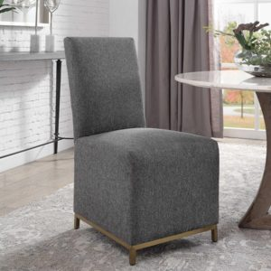 Armless dining chair by Uttermost displayed in an elegant dining room