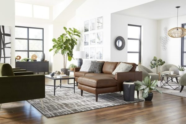 Leather sectional by Best Home Furnishings adding a fresh look for a living room makeover.