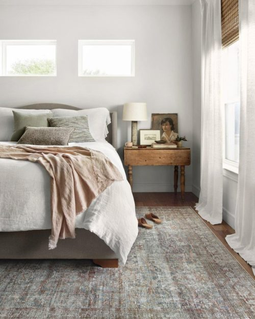 Rug by Loloi displayed with small bedroom furniture