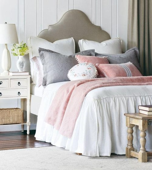 Bed set up by Eastern Accents that gives a Valentine's Day vibe.