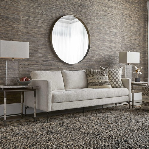 Cream colored sofa by Uttermost used for home decorating