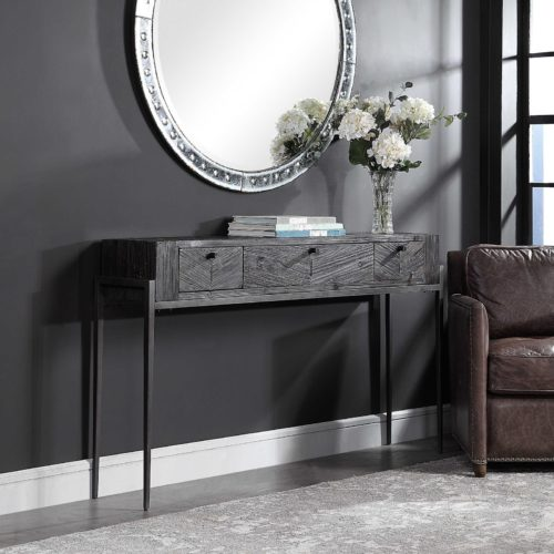 Dark grey console table by Uttermost adds the perfect touch for a moody home design.