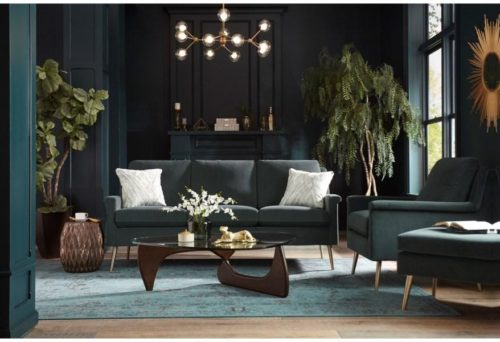 Dark green sofa by Best Home Furnishings pulling the moody home design together.