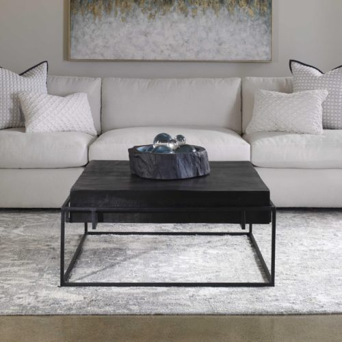 Dark colored decorative coffee tables by Uttermost.