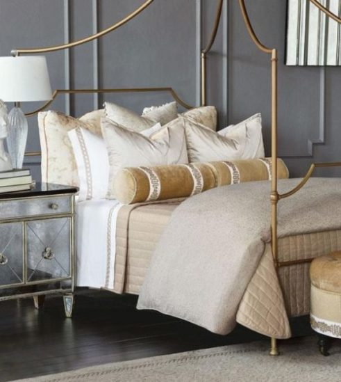 bedroom decor featuring a gold toned bed spread