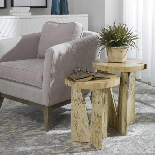 Round side tables with light wood finishes