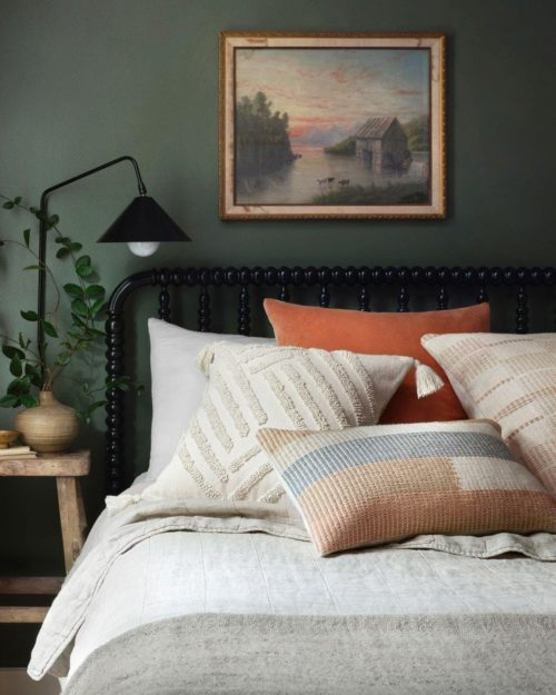 Black headboard complimenting wood finish side table