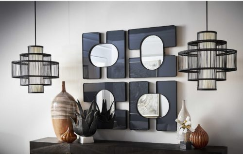 Interior design by Uttermost featuring creative hanging lights for the foyer.