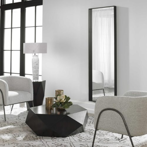 Hanging mirror wall decor in the formal living room for extra depth