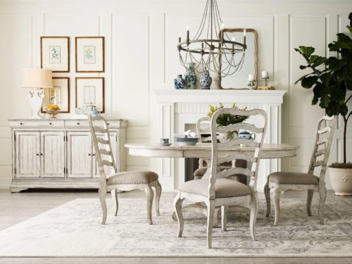 Cream colored round table dining room furniture piece by Kincaid