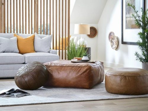 round leather furniture poof by Hammary for any room in the house.