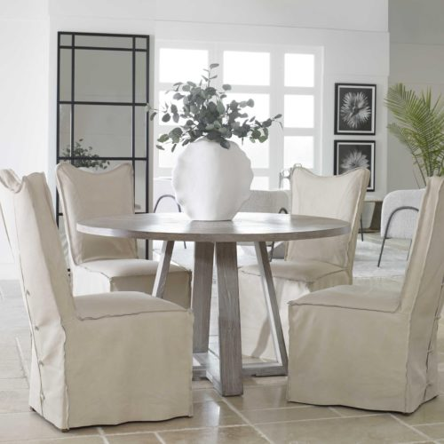Fabric Chairs with metal dining room table by Uttermost for fun furniture styles