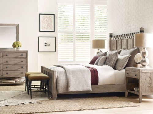 Leather furniture benches by Kincaid sitting at the foot of the bed
