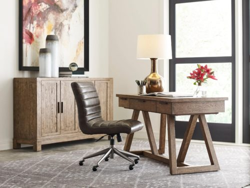 home office set up with a leather chair and wood style desk.