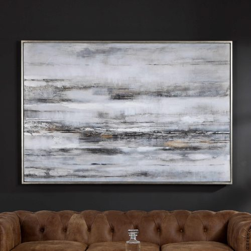 calming artwork pieces hanging in the den above the sectional